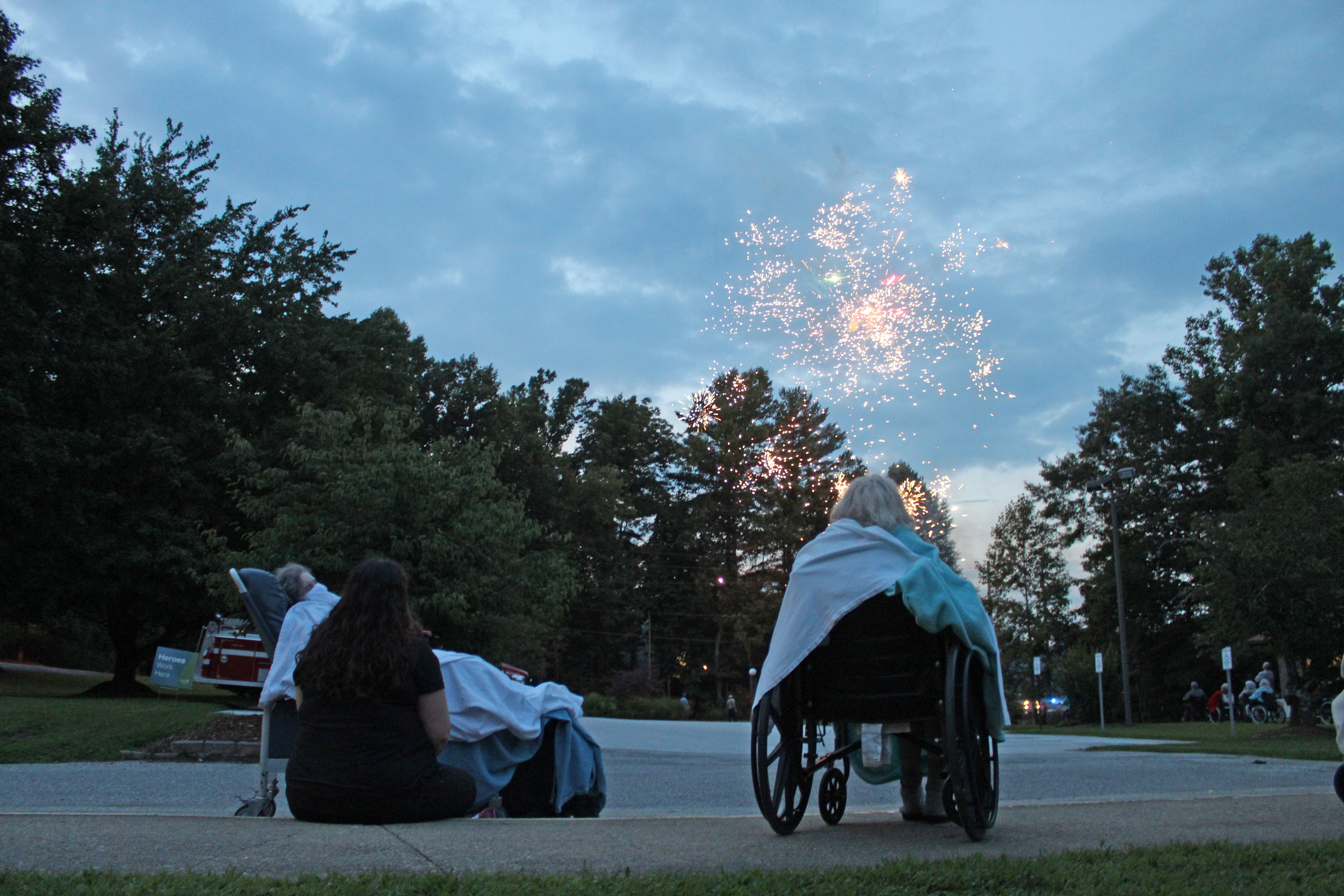 Brian Center residents cozy up with blankets as they watch a special fireworks show on Thursday, Aug. 20. Spruce Pine Police Chief Bill Summerlin raised funds to provide a show and ice cream for residents of the Brian Center and Mitchell House. (MNJ photo/Juliana Walker)