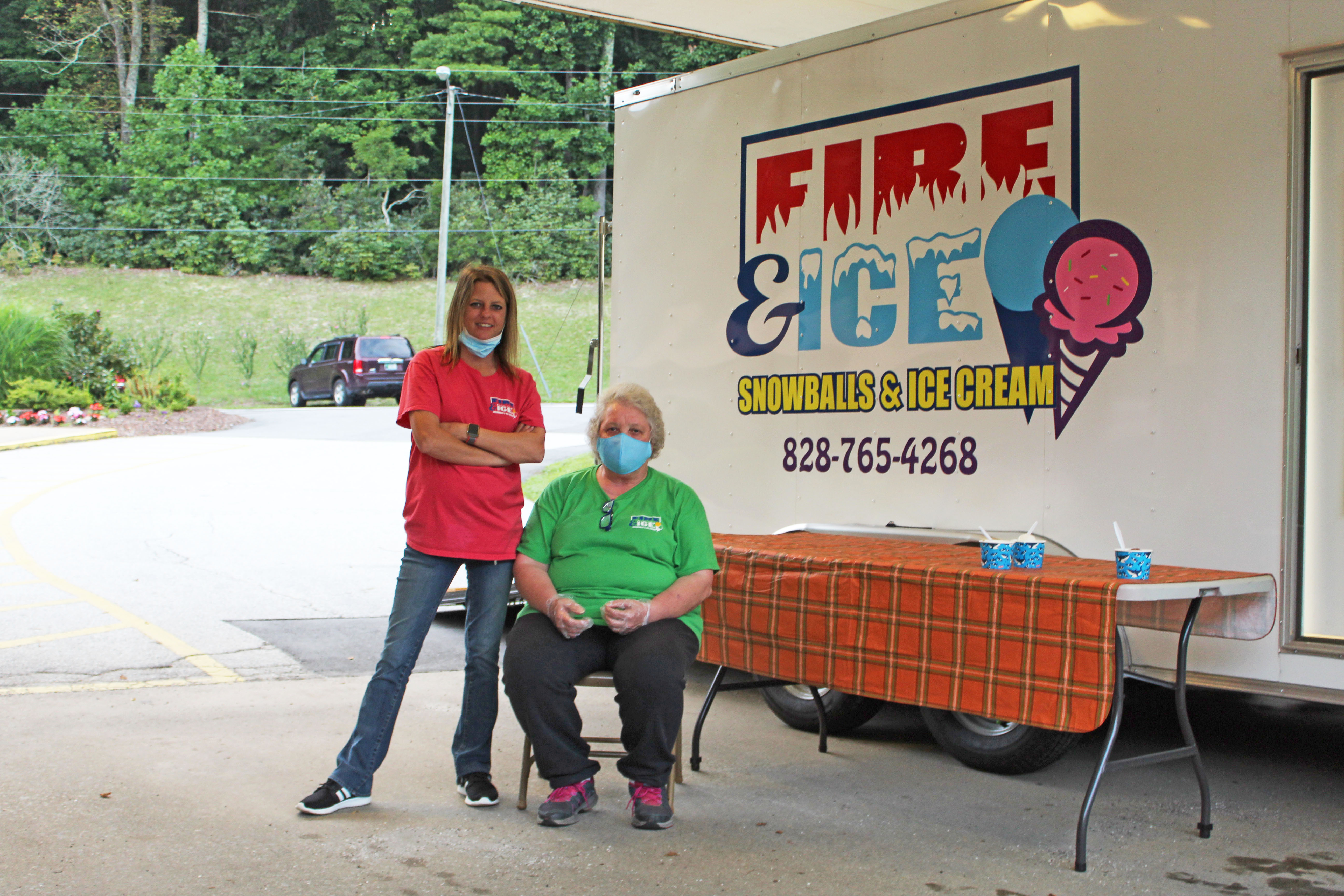 Employees of Fire & Ice Snowballs & Ice Cream sit ready for business at the Brian Center on Thursday, Aug. 20 during a special fireworks show for the seniors. (MNJ Photo/Juliana Walker)