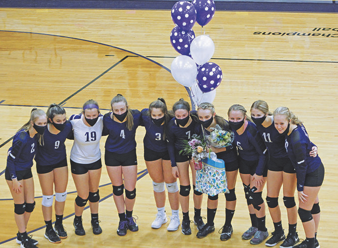 The Mitchell High School varsity volleyball team poses with its lone senior, Erika Gouge, before the start of its game against Mountain Heritage. (MNJ photo/Cory Spiers)