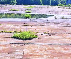 Mitchell County received a $97,500 grant to assist in the demolition and removal of 250,000 square-foot damaged and cracked concrete slab from the former Henredon manufacturing plant site. (Submitted)