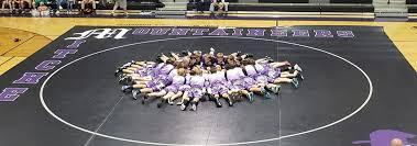 Wrestlers on mat