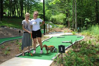Kim and Logan Oberhammer at Vic's Place Mini Golf Course.