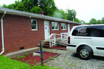 Neighbors Feeding Neighbors food ministry has found a new home in Spruce Pine. The building sits ready for visitors with the ministry van parked outside. Photo by Cory Spiers/MNJ.