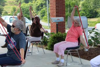 Class attendees stretch out their arms with exercise bands during an exercise class led by Mitchell County Director of Recreation Brock Duncan at the Senior Center. Pictured Left to Right: Mila Black, Jean Newton and Mattie Sparks. Photos by Juliana Walker/MNJ