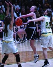 Mitchell senior Jill Pittman drives to the basket and avoids a pair of Alleghany defenders in a postseason road game this past season. Pittman, who helped the Mountaineers finish 22-6 and win four playoff games, now has two college offers from schools in Georgia.  (MNJ file photo)