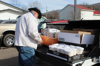 Mitchell County resident Tracy McIntyre loads his vehicle with barbecue before heading on his delivery route. (MNJ photo/Juliana Walker)