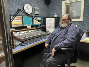 Bruce Ikard, who has served as the primary announcer for WTOE for the majority of the past four decades, sits in the WTOE control room during a normal day in the office. WTOE recently added an FM station in an effort to expand its coverage to more people in the region.  (MNJ photo/Juliana Walker)